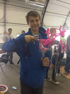 Son David building an adorable Barbie bike!